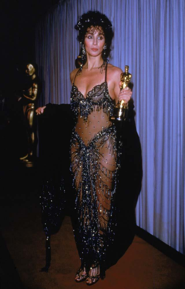 """***Cher in Bob Mackie, 1988***<br><br> Back before naked dresses were a thing, Cher was brave enough to wear this sheer look to the 1988 Oscars. """"We look back now and those designs seem amazing and fantastic, but it's important to remember that the moment Cher stepped out of the limousine and into the spotlight, it wasn't instantly known that what she was going to wear was going to be acceptable and not laughed at,"""" said Kevin Jones of the look."""