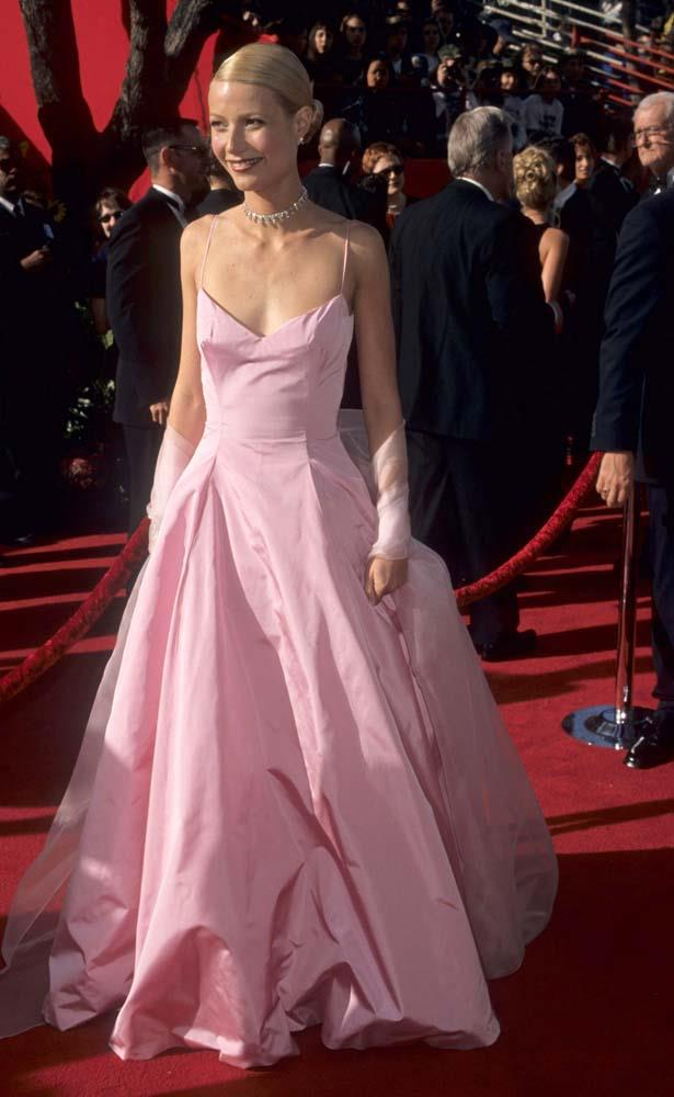"""***Gwyneth Paltrow in Ralph Lauren, 1999***<br><br> One of the most famous Oscars dresses in history, Gwyneth Paltrow's Ralph Lauren ballgown (which she notes she still owns as a keepsake for her daughter, Apple) was credited with """"bringing pink back into fashion."""""""