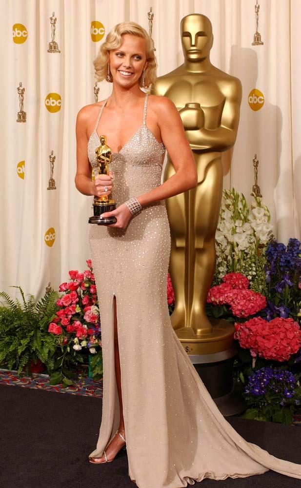 ***Charlize Theron in Gucci, 2002***<br><br> Although her beaded Gucci gown was a hit, critics zeroed in on Theron's deep bronze tan, which washed out her blonde eyebrows.