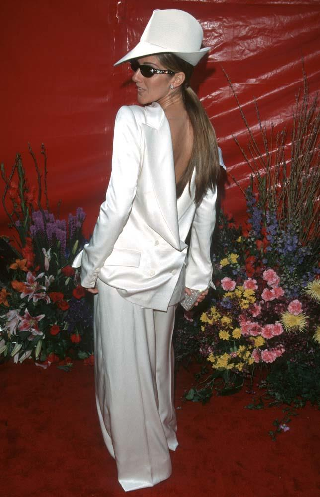 ***Celine Dion in Dior, 1999***<br><br> Celine Dion made headlines when she decided to wear the jacket of her white Dior suit backwards, pairing it with white trousers, a matching fedora and sunglasses.