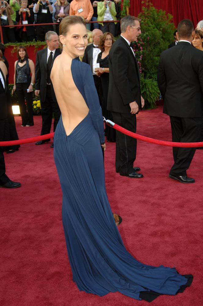 ***Hilary Swnnk in Guy Laroche, 2005***<br><br> Voted as one of the best Oscars dresses of all time, this plunging dress made headlines for its dangerously low back.