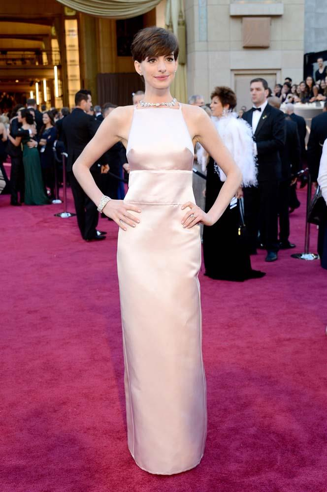 """***Anne Hathaway in Prada, 2013***<br><Br> Despite being a very beautiful dress, Anne Hathaway's Prada moment in 2013 got a lot of attention for the darts on the chest. """"I look in the mirror, turn to (her husband) Adam, and say, 'It looks like my nipples are hard.' He says, 'You look beautiful. Your nipples look pointy. The red carpet's about to close. We gotta go',"""" Hathaway told *[Harper's BAZAAR US](https://www.harpersbazaar.com/culture/features/a3888/anne-hathaway-interview-1114/