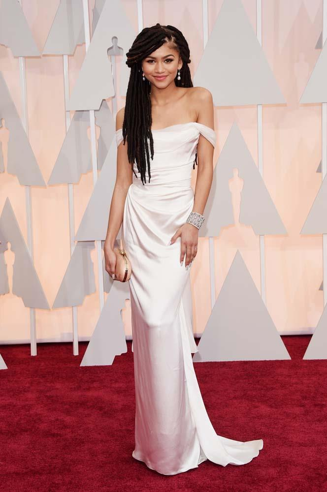 """***Zendaya in Vivienne Westwood, 2015***<br><br> It wasn't Zendaya's Vivienne Westwood gown that was the subject of controversy in 2013, but her faux dreadlocks. Upon seeing her on the red carpet, E! *Fashion Police* host Guiliana Rancic commented that the style made her """"feel like she smells like patchouli... or weed,"""" a comment many deemed to be racially insensitive. Zendaya later released a commented that noted that """"there is a fine line between funny and disrespectful,"""" and that there was enough """"harsh criticism of African American hair in society without the help of ignorant people."""""""
