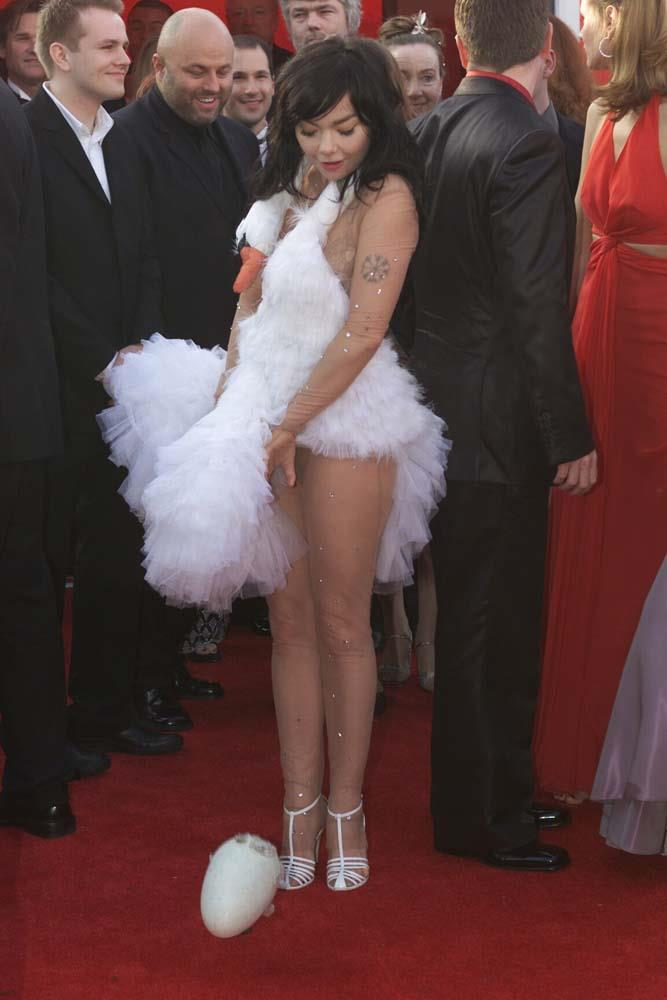 """***Björk in Marjan Pejoski, 2001***<br><br> One of the most iconic Oscars dresses of all time, Bjork wore a wrap-around swan to the 2001 ceremony. She even 'laid an egg' on the red carpet (much to the embarrassment of her 14-year-old son, who was her date). Later she commented on the controversy saying, """"It's just a dress... I don't really know why I'm obsessed with swans but as I said, everything about my new album is about winter and they're a white, sort of winter bird. Obviously very romantic, being monogamous. It's one of those things that maybe I'm too much in the middle of to describe. When you're obsessed with something, you can explain it five years later, but in the moment, you don't know exactly why. Right now, swans seem to sort of stand for a lot of things."""""""