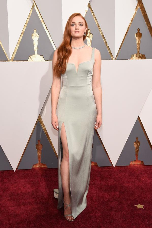 **CAPRICORN** <br>Your colour: Grey <br>Responsible, disciplined and mature, Capricorns favour minimalist designs and clean charcoal and grey hues, like Sophie Turner's Galvan slip dress.