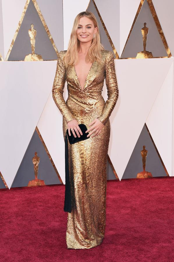 **LEO** <br>Your colour: Gold <br>Passionate, confident and generous, Leos are natural born leaders. A dramatic statement dress like Margot Robbie's luminous gold gown allows the Leo to bask in the spotlight.