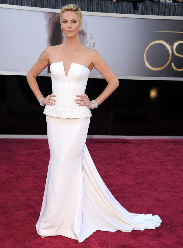 **CANCER** <br>Your colour: White <br>Cancer's loyality and high emotional IQ lends themselves to pure and harmonious colours like Charlize Theron's white Dior dress.