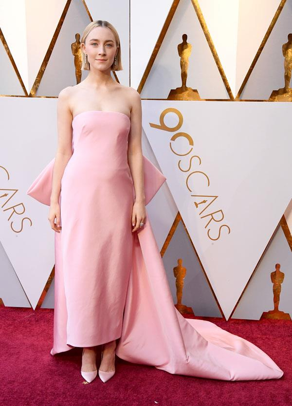 **TAURUS** <br>Your colour: Pink <br>Grounded and sensual, clean architectural silhouettes like Saoirse Ronan's Calvin Klein dress suit Taurus's practical nature, while pink appeals to their romantic side. Taurus are tactile, so beautiful smooth silk is the perfect fabric for this sign.