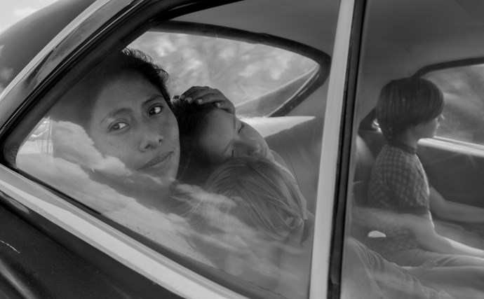 ***ROMA*** <br><br> *ROMA* follows Cleo (Yalitza Aparicio), a young domestic worker for a family in the middle-class neighborhood of Roma in Mexico City. Delivering an artful love letter to the women who raised him, director Alfonso Cuarón draws on his own childhood to create a vivid and emotional portrait of domestic strife and social hierarchy amidst political turmoil of the 1970s.