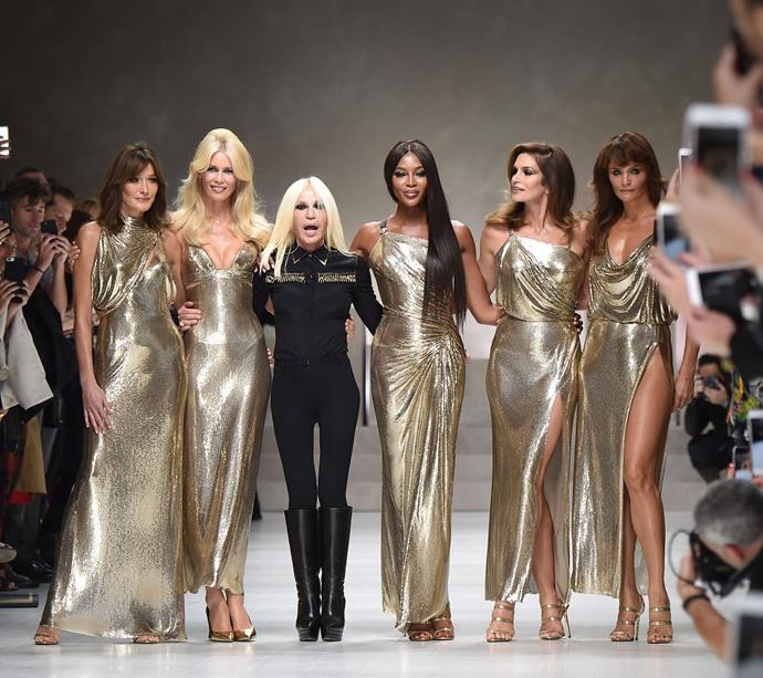 Carla Bruni (age 51) and Cindy Crawford (age 53) with Claudia Schiffer, Donatella Versace, Naomi Campbell and Helena Christensen at Versace spring/summer '18.
