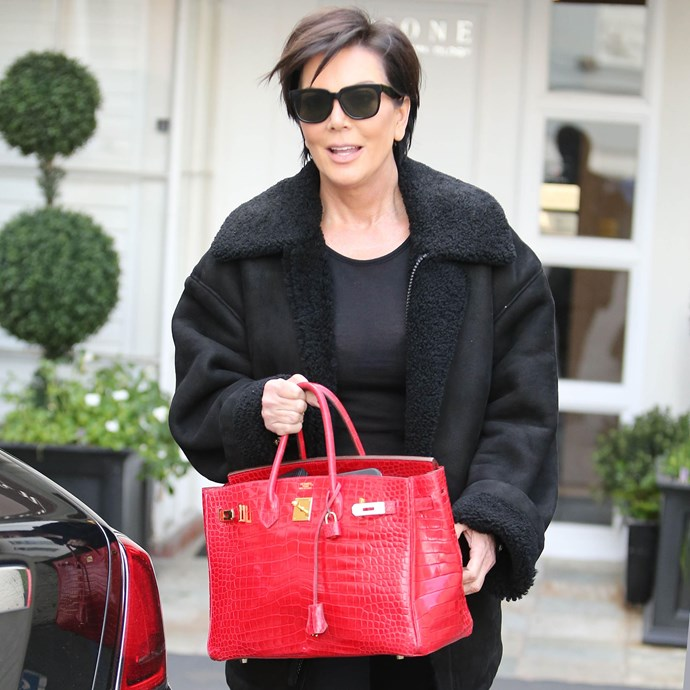 ***Kris Jenner*** <br><br> Kris's exotic collection also includes crocodile-skin Birkins in a handful of bright colourways. Pictured here is one of her red Birkin 35s, which likely retails for over $80,000.