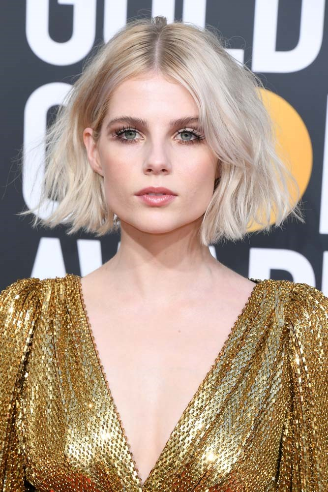 """***The Chelsea-Girl Bob***<br><br> *As seen on: Lucy Boynton, Emilia Clarke and Nathalie Kelley.*<br><br> """"This look is all about the cut, the strength comes from the silhouette–blunt, strong and bold. It has one solid layer through the front and blunt cut at the ends. <br><br> """"Lucy has her hair cut just below the chin and while all face shapes can pull off a chunky bob, where you put your baseline will depend on your face shape."""""""