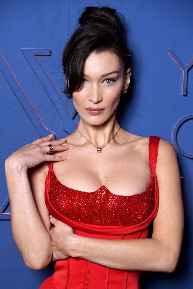 """***The Elevated Top-Knot***<br><Br> *As seen on: Bella Hadid, Laura Harrier, Behati Prinsloo.*<br><Br> """"Bella always looks expensive and it's because she will often add a slight design element or a point of interest to her hairstyle that elevates it from every day to next level. With this it's the exaggerated fringe section. This look is no exception and something I think a lot of others will emulate."""""""