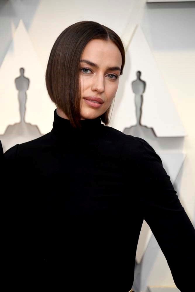 """***The High-End Bob***<br><br> *As seen on: Irina Shayk, Charlize Theron, Dua Lipa, Rose Byrne.*<br><br>   """"Again, tweaks to the cut are what make this look. It's still all one length but has a slight concave at the back, which helps it sit close to the neck. What makes such a simple cut look this expensive is the finish—the part is dead centre, the hair is dead straight and there isn't a single hair out of place. Irina's bob wouldn't move! <br><br>  """"They key with this look is to apply hairspray layer by layer, brushing it down and into place. If you apply as a finishing step to the top layer only the underneath will separate and move. You need each layer to stick to the previous layer."""""""