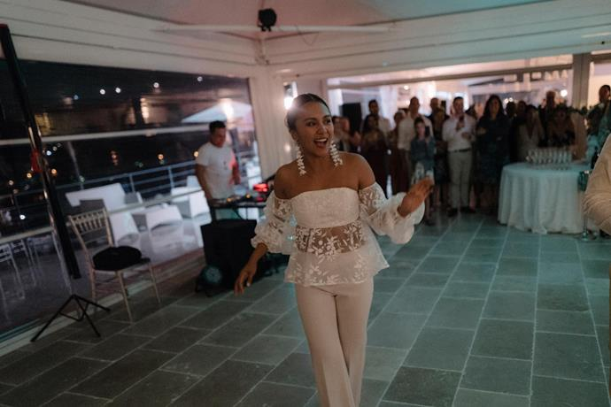 **Was there an outfit change for the reception?** Yes! A bride's got to be able to get down on the dancefloor. I changed into pants by Theory and an Asilio top that had embroidered white flowers that matched my earrings perfectly.
