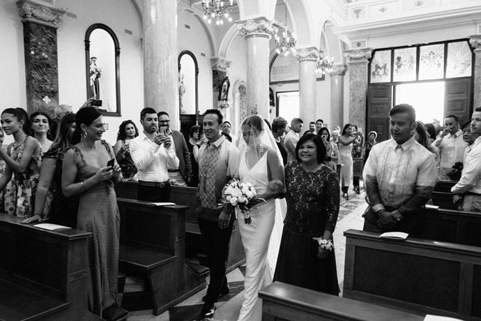 **On her arrival to the ceremony:** My parents walked me down the aisle to Wagner's Bridal March. My heart leapt out of my chest when I heard the first chords playing, I was so nervous!