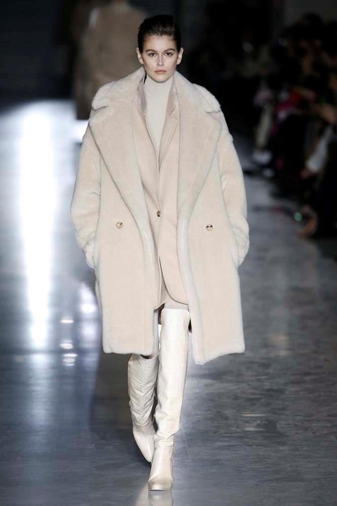 ***Fluffy Coats***<br><br> Level up cold-weather coats by embracing soft-as-butter faux faux, feather details and oversized shapes.<br><br> Max Mara autumn/winter '19.