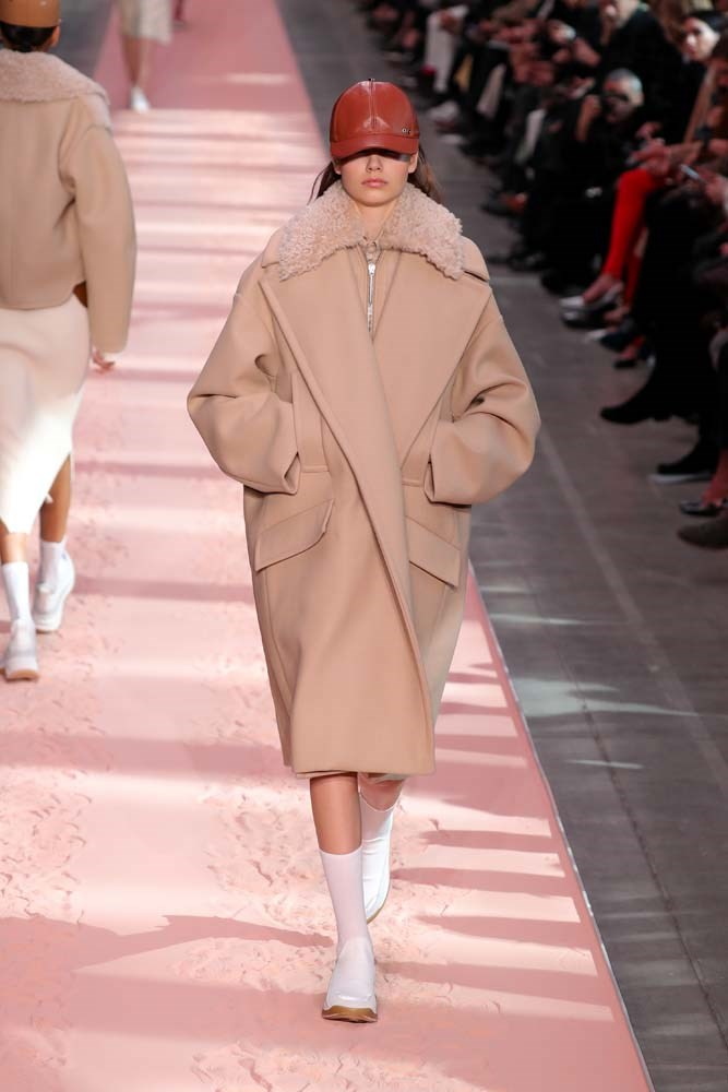 ***Fluffy Coats***<br><br> Level up cold-weather coats by embracing soft-as-butter faux faux, feather details and oversized shapes.<br><br> Sportmax autumn/winter '19.