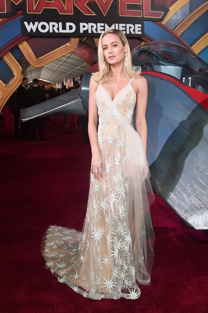At the world premiere of *Captain Marvel* on March 4, 2019, Larson wore a showstopping custom Rodarte gown, which featured a sheer tulle overlay and embroidery featuring Captain Marvel's signature eight-pointed star, which is her emblem.