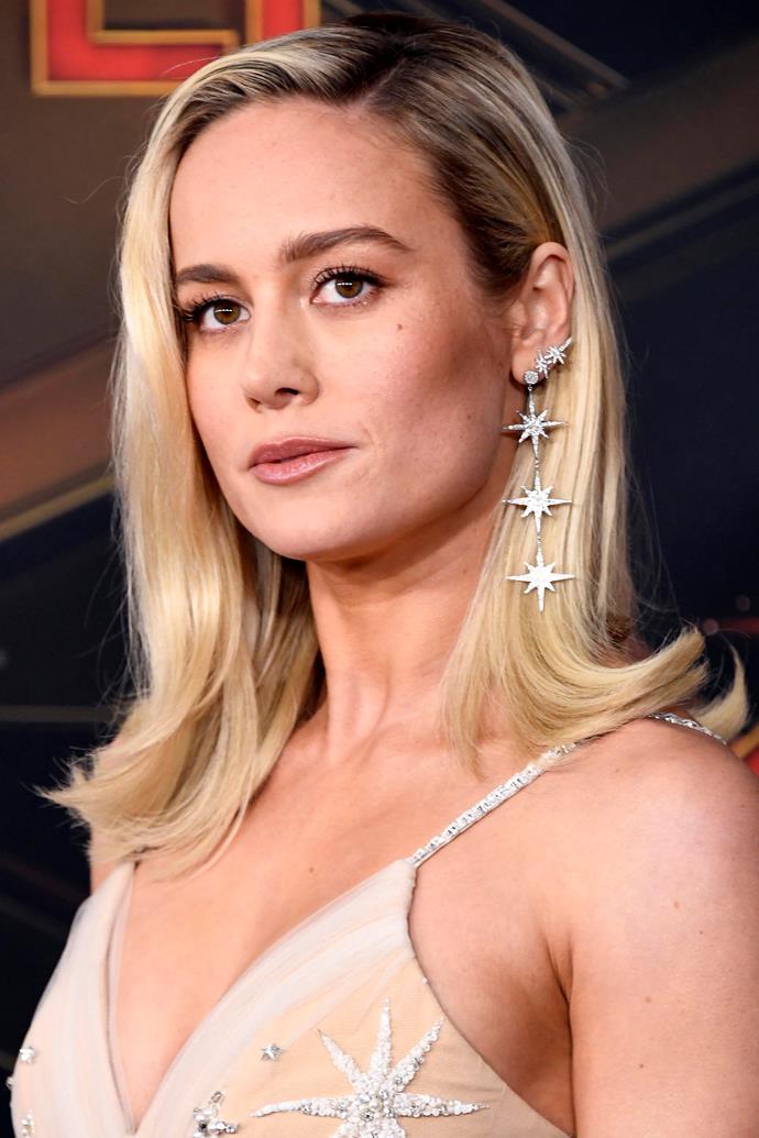 "McMillen, Larson's stylist, also shared pictures of Larson's starry, comic book-friendly earrings, designed by jeweller [Sydney Evan](https://www.instagram.com/sydneyevan/|target=""_blank""|rel=""nofollow"")."