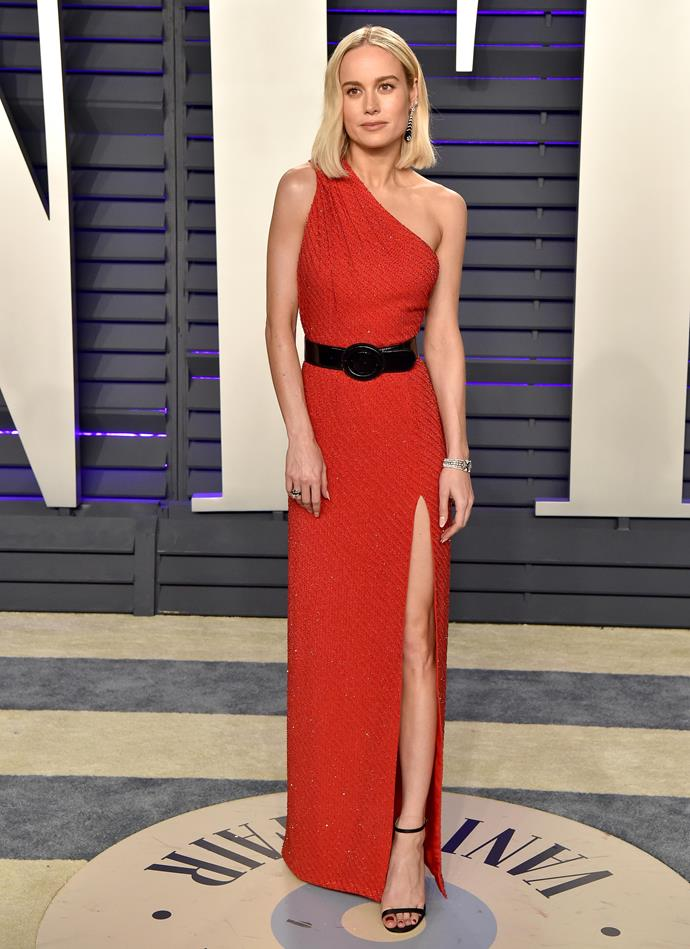 At the *Vanity Fair* Oscar Party on the same night, Larson changed into an equally slinky Celine by Hedi Slimane gown, with a statement black belt (as anyone knows, a utility belt is *crucial* for any superhero).