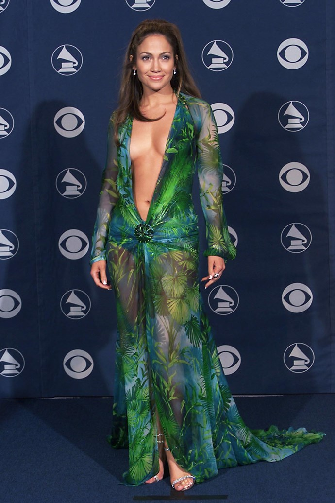 "**Jennifer Lopez at the Grammy Awards (2000)** <br><br> This Versace gown was originally modelled by Amber Valletta, but the world went gaga when J-Lo wore it at the 2000 Grammys. When she presented on stage with *The X-Files* actor David Duchovny, he famously said: ""This is the first time in five or six years I'm sure that nobody is looking at me."""