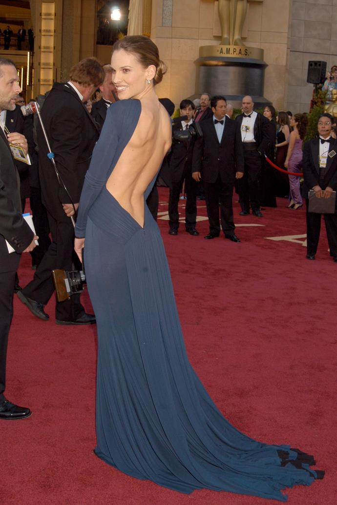**Hilary Swank at the Academy Awards (2005)** <br><br> When Swank won the Oscar for *Million Dollar Baby* in 2005, her Guy Laroche dress became one of the most iconic in Oscars history. Leaving her front completely covered, the rear of the dress left her back completely exposed, in a plunging back that stopped just above her derrière.