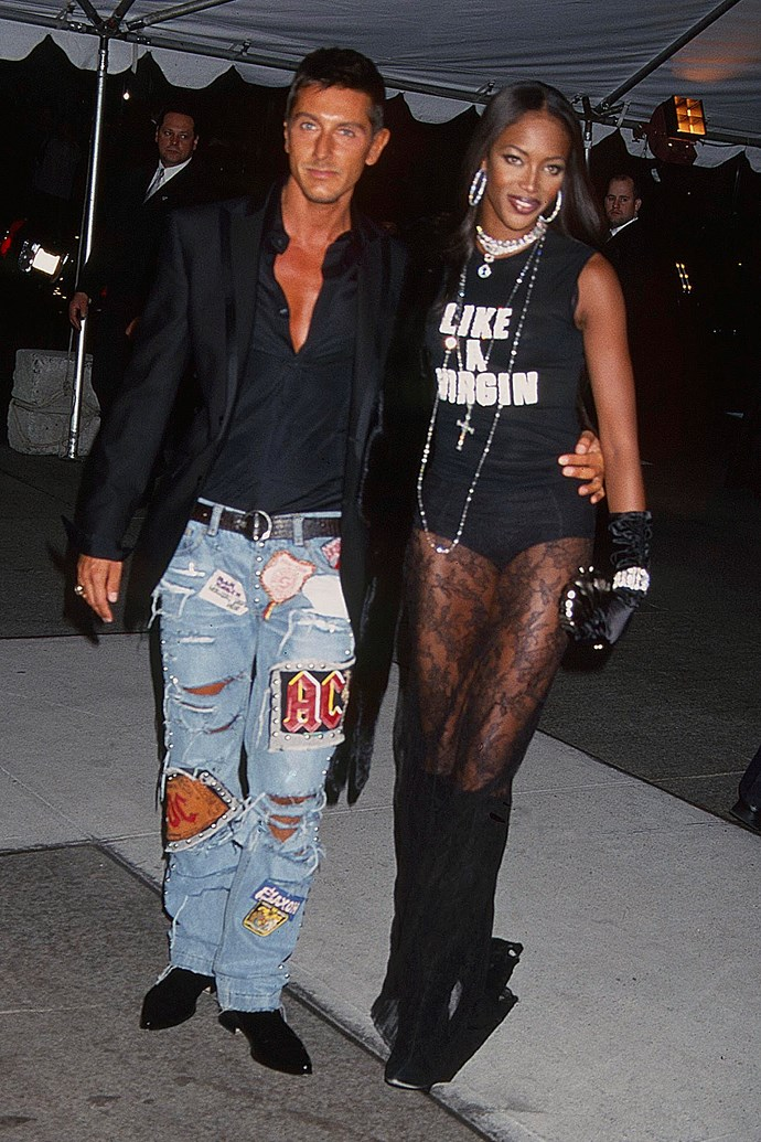 **Naomi Campbell at the Met Gala (2001)** <br><br> The theme for the 2001 Met Gala was 'Jacqueline Kennedy: The White House Years'—but by the look of her outfit, Naomi Campbell might have missed the memo. She attended the event in a bold t-shirt and sheer skirt, alongside her close friend Stefano Gabbana, who wore ripped, badge-adorned jeans.