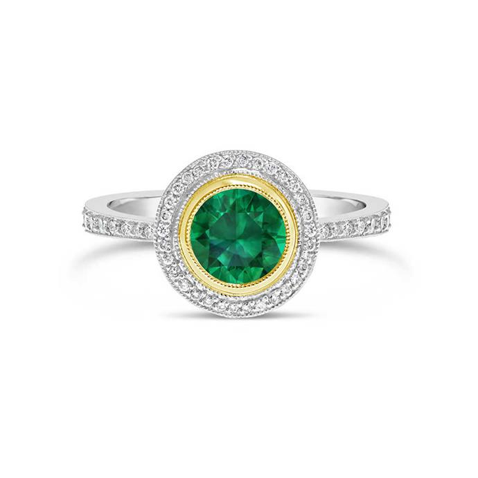 "**The Vibe: A Hint Of Gold** <br><br> Round-cut emerald and diamond halo ring set in a fine yellow gold bezel setting, POA at [Fairfax & Roberts](https://www.fairfaxandroberts.com.au/product/emerald-diamond-halo-engagement-ring/|target=""_blank""