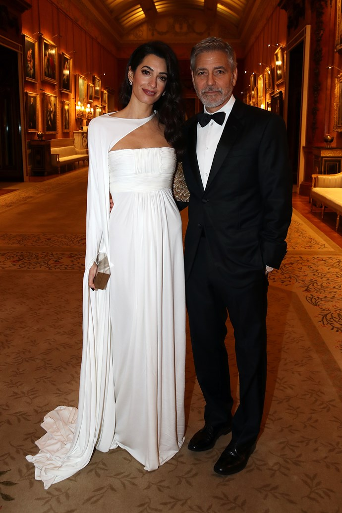 Amal and George Clooney at Buckingham Palace on March 12, 2019.
