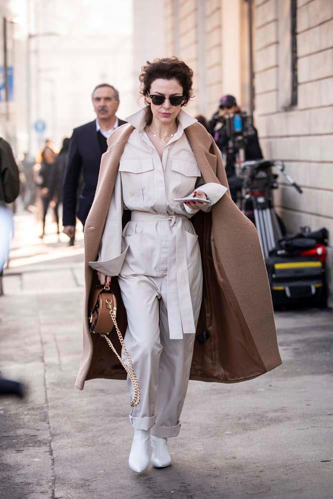 ***One and done***<br><bR> With the sun rising later and the temperatures dropping steadily, the siren call of a one-piece to simplify morning dressing is irresistible. A boilersuit in a neutral shade can be dressed up or down.