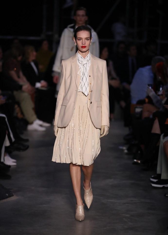 Natalia Vodianova walks the runway at the Burberry show at London Fashion Week.