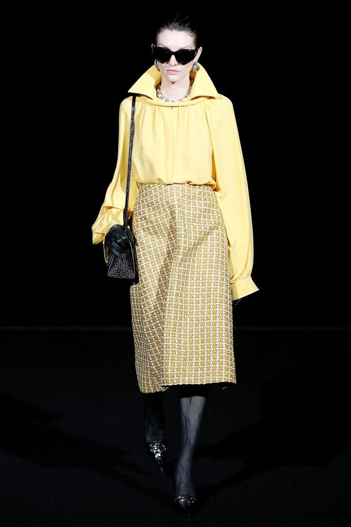 A model walks the runway at the Balenciaga A/W '19 show at Paris Fashion Week.