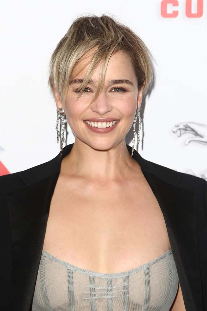 """***The Grown-Out Pixie***<br><br> """"For anyone ready to take their bobs even shorter we are going to see the return of the short cut. But rather than it looking super polished, think lived-in and relaxed, almost like a pixie haircut that has grown out,"""" Scandizzo tells *BAZAAR*. <br><br> """"People think that pixies are hard to pull off but it comes down to a really good cut and working with a stylist that knows how to work with your bone structure. Very short pixie cuts tend to suit those with more delicate features but keeping layers a bit longer will highlight the eyes and draw the eye down, making the rounder faces appear longer. Michelle Williams is someone who has the perfect pixie cut for her face shape."""" <br><br> """"The trick to nailing this is to wear it more natural, don't over style it with product. Rather than a stiff wax, go for [low hold cream](https://elevenaustralia.com/product/frizz-control-shaping-cream/