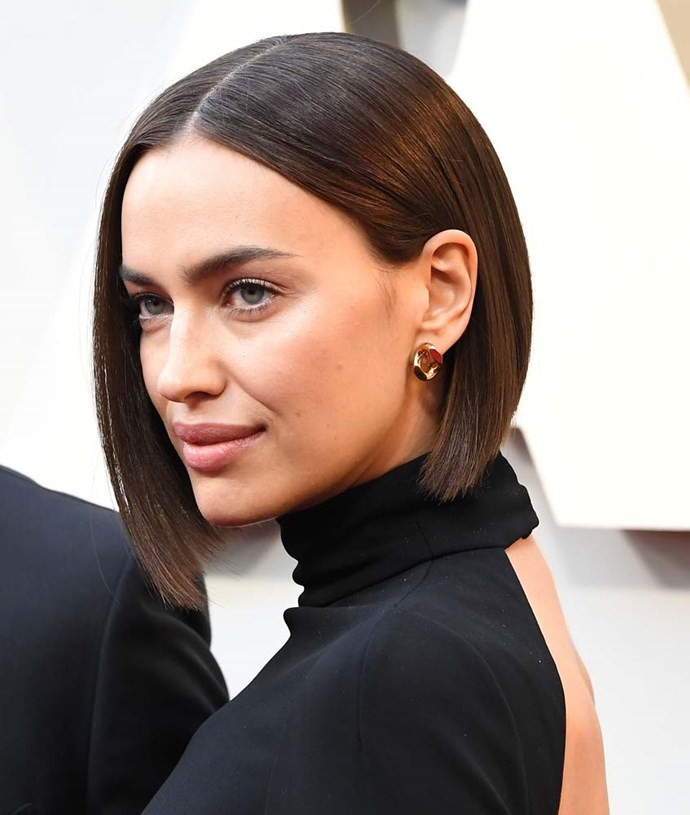 """***The Sleek Blunt Bob***<br><br> """"The bob is back in a big way this season! We've seen so many celebrities make the chop lately, going for super chic and sleek cuts. The best thing about the bob is that it really suits all hair types and face shapes—how short you go will depend on your bone structure, but the short, blunt bob works with all hair types from wavy to straight,"""" says Scandizzo.<br><br> """"The key to this cut is keeping the exterior or bottom line blunt and sharp, because that's where the drama comes from. Also make sure you're booking in for regular trims—the ends need to be kept blunt and clean for your hair to look polished. Even more so if you have a fringe.""""<br><br> """"The glass hair trend is still going strong, just look at Irina Shayk's hair at the Oscars. We're seeing a return to blunt ends, shiny finishes and healthy-looking hair. [Serums](https://elevenaustralia.com/product/smooth-shine-anti-frizz-serum/