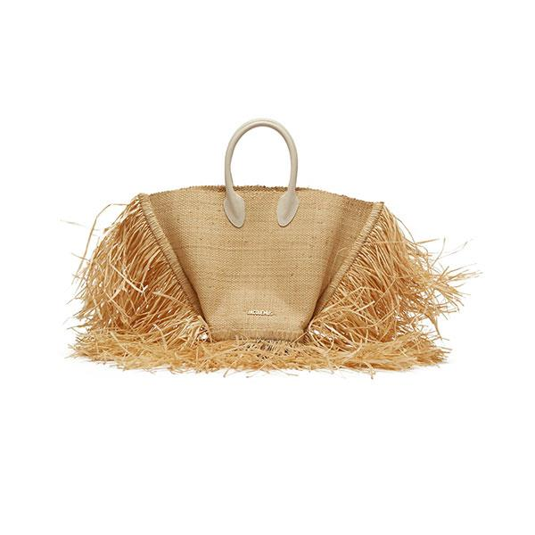 "**Buy:** <br><br>Handbag by Jacquemus, $638 at [MATCHESFASHION.COM](https://www.matchesfashion.com/au/products/Jacquemus-Le-Baci-woven-basket-bag-1253075|target=""_blank""