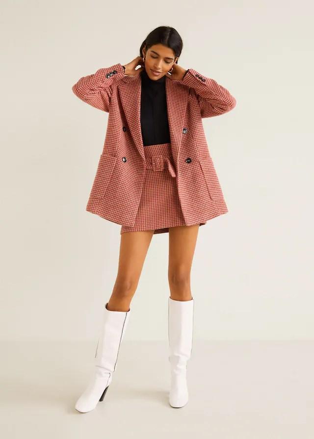 "Purchase the [jacket](https://shop.mango.com/au/women/coats/houndstooth-coat_41080770.html|target=""_blank""|rel=""nofollow"") for $229.95 and the [skirt](https://shop.mango.com/au/women/skirts-short/check-miniskirt_41090798.html|target=""_blank""|rel=""nofollow"") for $79.95."