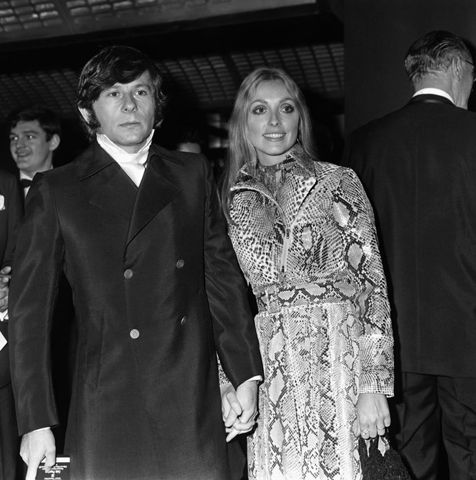 Wearing a snakeskin-print trench dress in 1965.