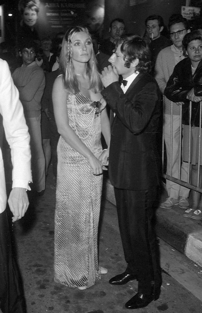Walking a red carpet with Polanski with hair braids and pearls.
