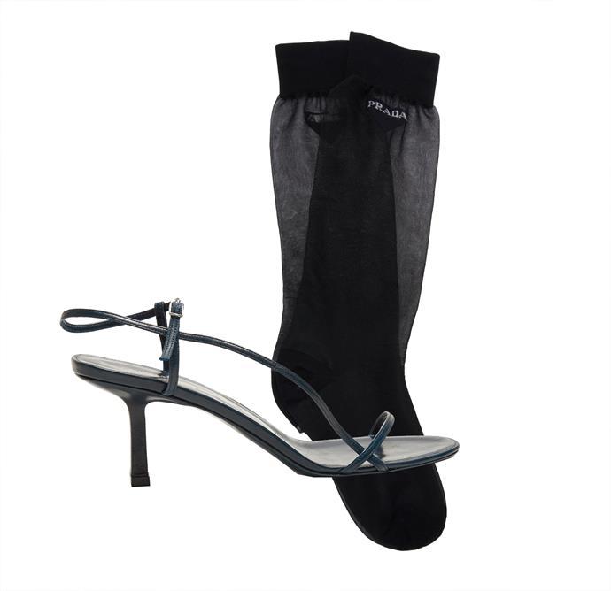 "Sandals by The Row, $923 at [MATCHESFASHION.COM](https://www.matchesfashion.com/au/products/1219922|target=""_blank""|rel=""nofollow""); Socks by Prada, $260 at [Moda Operandi](https://www.modaoperandi.com/prada-ss19/long-logo-socks|target=""_blank""|rel=""nofollow"")."