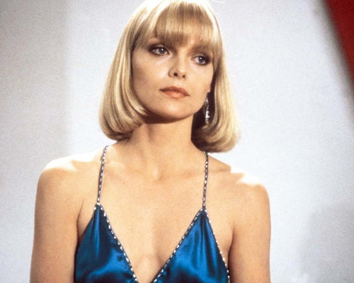 Michelle Pfeiffer's sleek blonde bob and smoky eye in *Scarface* are still copied today.
