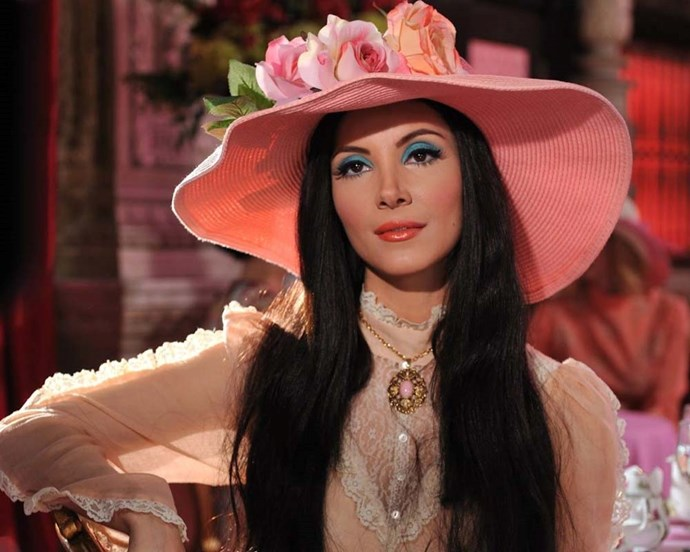 Elaine's electric blue eye and coral lip in *The Love Witch* was a perfect nod to the '70s.