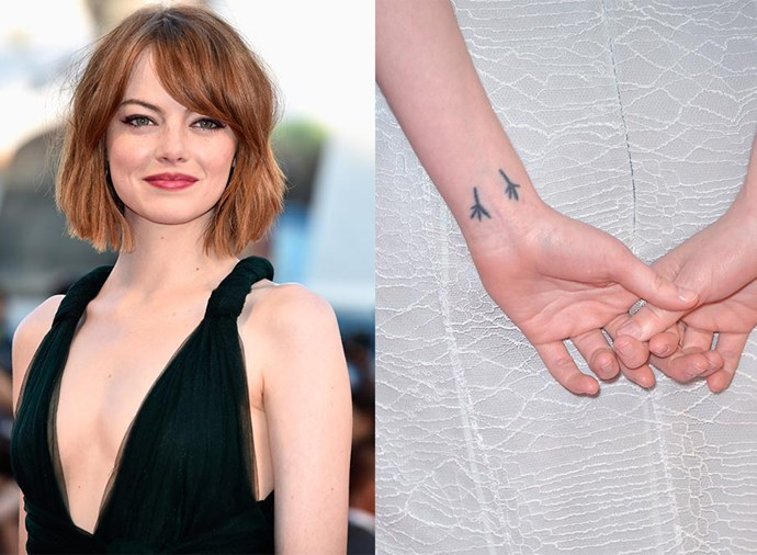 """**EMMA STONE** <br><br> There's an incredible story behind the actress's ink: After her mother beat cancer, she got a tattoo of two bird's feet as a nod to her mum's favourite song, *Blackbird* by Paul McCartney. The twist? McCartney himself designed it. """"I wrote a letter to Paul McCartney asking him if he would draw two little bird feet, because he wrote the song, and yesterday he sent them to me…Custom tattoos by Paul McCartney. Isn't that wild? Unbelievable. He's a good guy,"""" she told David Letterman."""