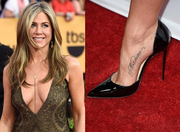 """**JENNIFER ANISTON** <br><br> Aniston has the name Norman tattooed on her foot. Doesn't ring a bell? That's because it's not the name of an ex-boyfriend, but rather the name of her late Welsh Corgie-Terrier. """"I never thought that would ever happen,"""" Aniston told *ET Canada*. """"It's just my way to pay homage to him... forever."""""""