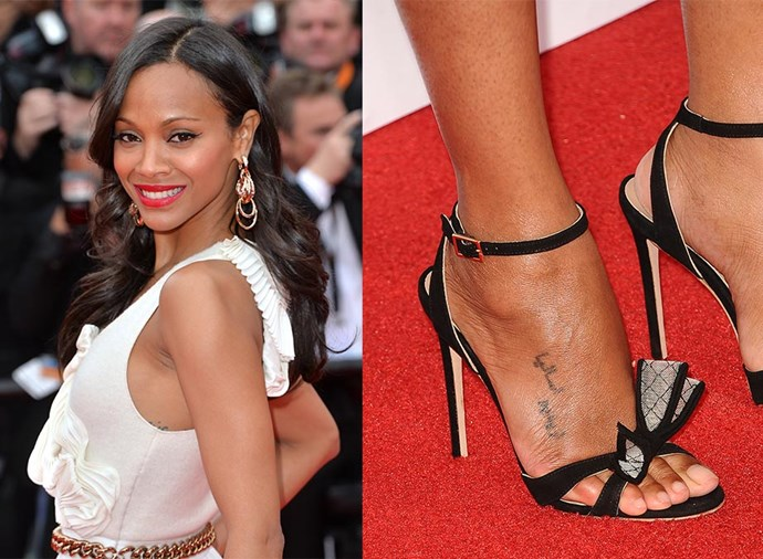 """**ZOE SALDANA** <br><br> Saldana has 10 tattoos, most of them small and out of sight, with the actress joking to David Letterman that she's """"running out of private places to put them on""""."""