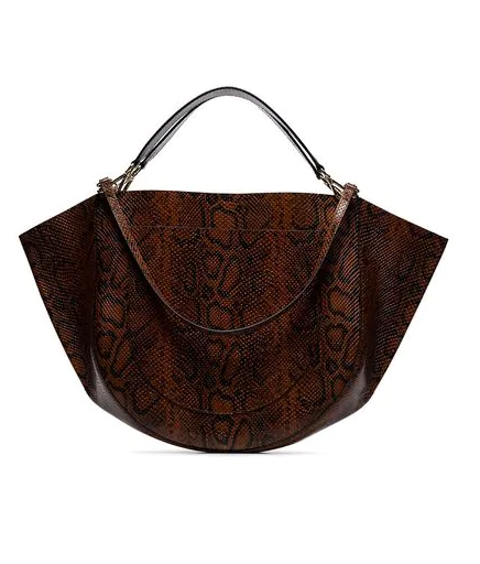 """Buy: Python Embossed Leather Tote Bag by Wandler, $1,425 at [Farfetch](https://www.farfetch.com/au/shopping/women/wandler-brown-mia-python-embossed-leather-tote-bag-item-13497102.aspx?storeid=9359