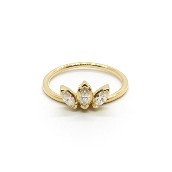 "Three Stone diamond ring, $1,750 at [Natalie Marie Jewellery](https://www.nataliemariejewellery.com/collections/rings/products/three-stone-diamond-sun-ring|target=""_blank""|rel=""nofollow"")."