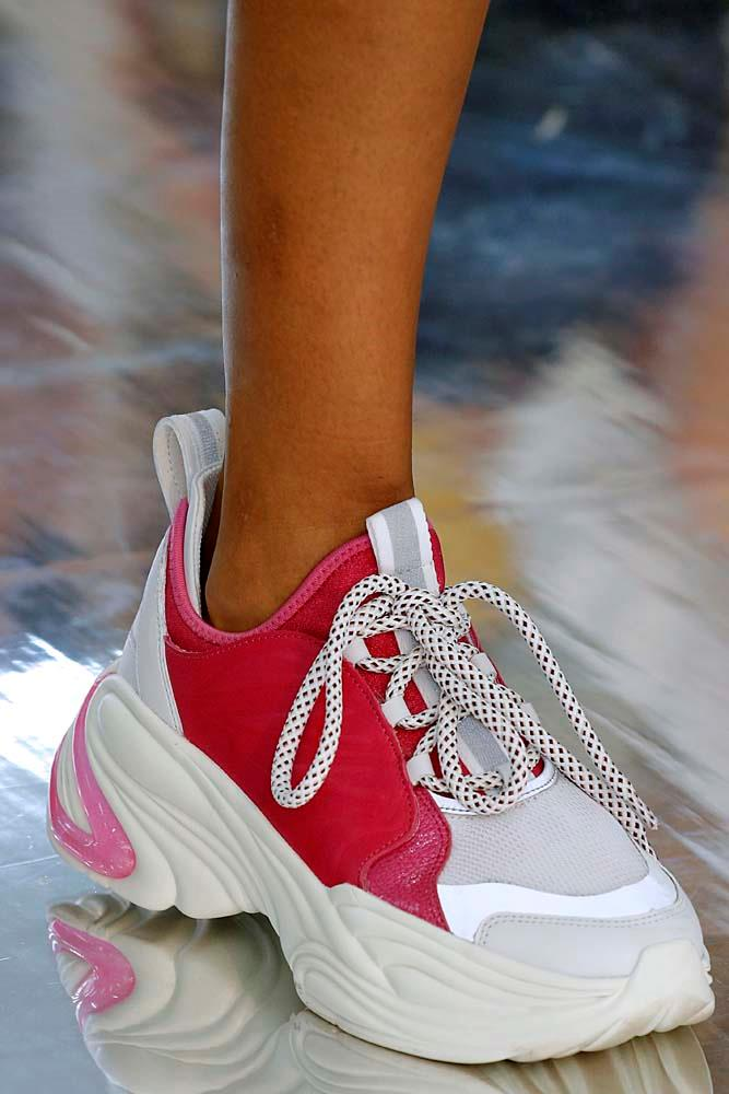***DAD SNEAKERS***<br><Br> Forget rainboots and Converse, the California greens will see plenty of 'dad sneakers' this month. From souped up versions by Gucci and Balenciaga, to sportier 'adventure sneakers,' these are a shoo-in.<br><br> *Pictured: Byblos spring/summer '19.*