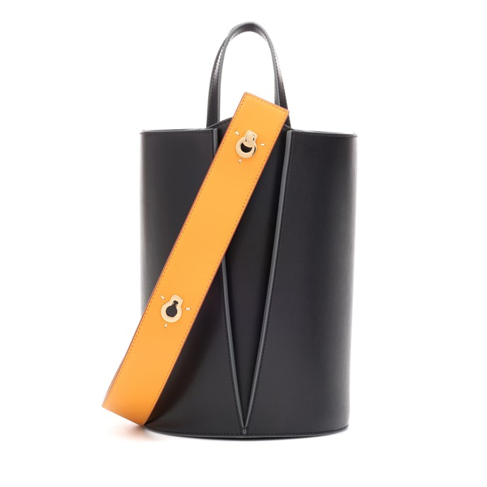 """""""I alternate this with another MVP bag but it basically gets worn most days. I love that it hasn't lost its structure, and the orangey-tan strap makes for a slight pop of colour."""" – Elle McClure, Culture Director. <br><br> Bag by Danse Lente, $779 at [My Theresa](https://www.mytheresa.com/en-de/danse-lente-mini-lorna-leather-bucket-bag-1037501.html