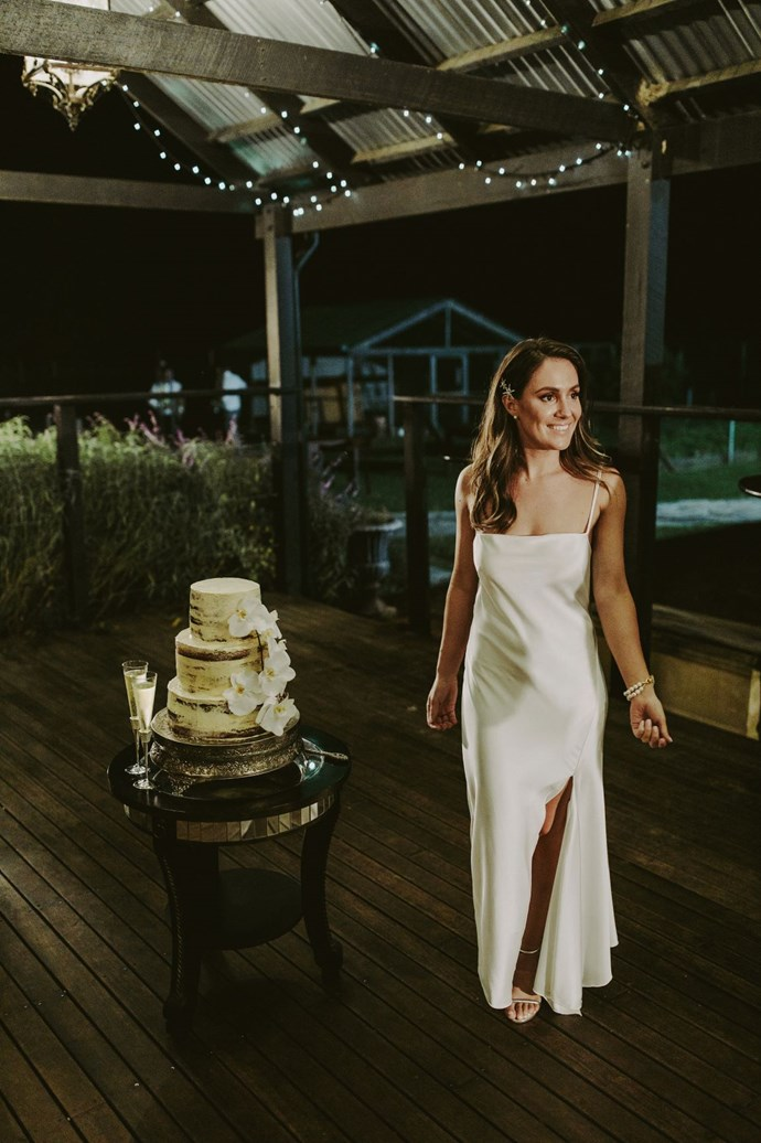 **Was there an outfit change for the reception?** I changed into a Camilla & Marc white slip for our first dance so I could break it down on the dance floor.
